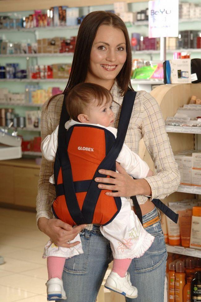 Как носить ребенка в